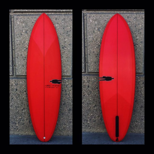 "A fire engine / crayola red Bullet. 6'1"" x 20"" x 2 5/8"" 35L headed to Mark 28/6'2""/195lb/12 yrs ... annual split between Oahu & Oregon/for Oregon beachbreaks and points #bulletsinglefin"